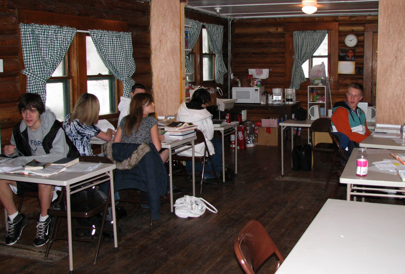 Students working in another area of the cabin
