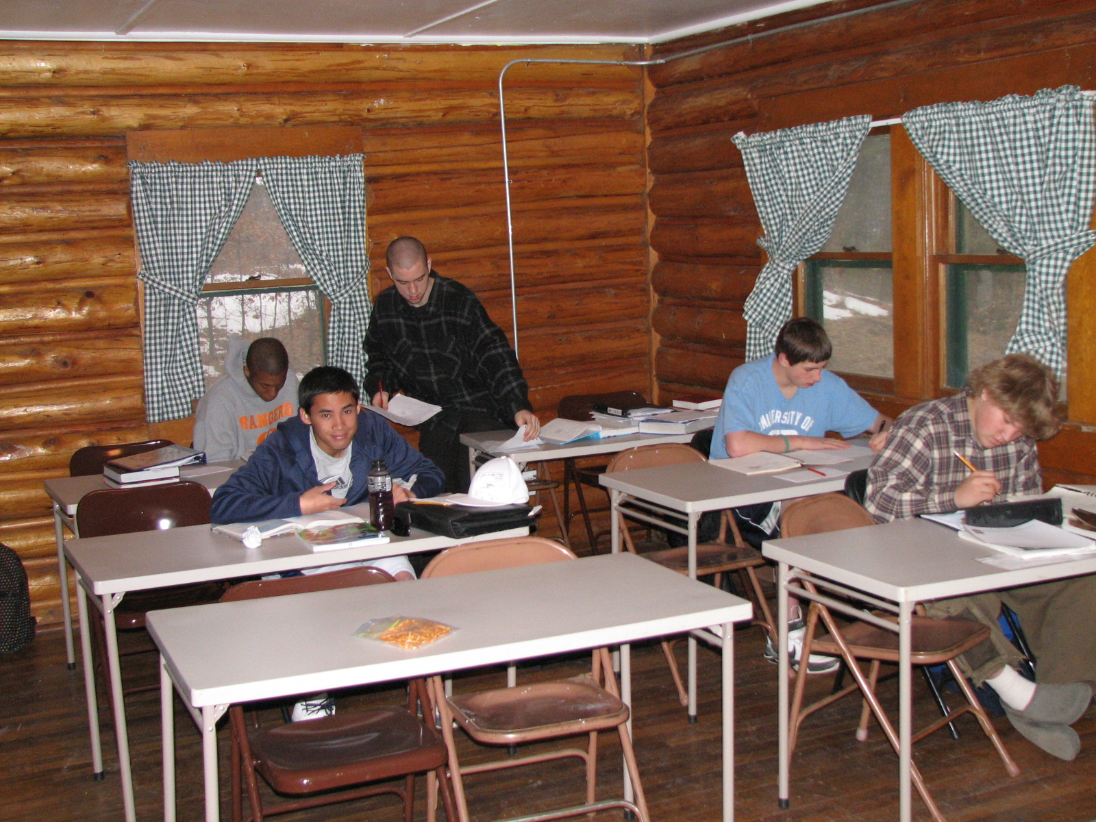 Students working in one area of the cabin